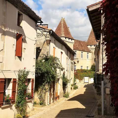 Narrow old street in St Jean de Cole in the summer sun