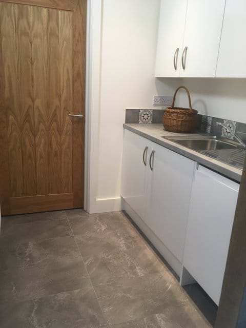 Downstairs utility area with washing machine