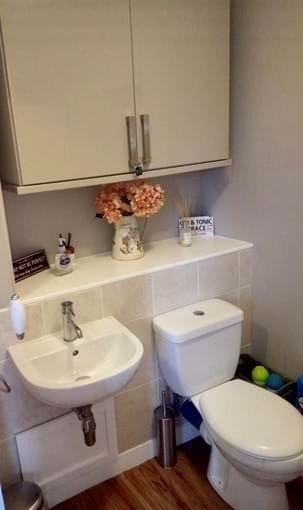 Downstairs guest bathroom/utility with washing machine and tumble dryer