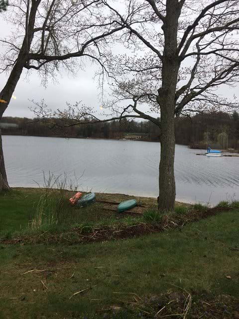 View of the Lake, early spring.  There are row boats , paddle boats, kayaks, and paddle boards.