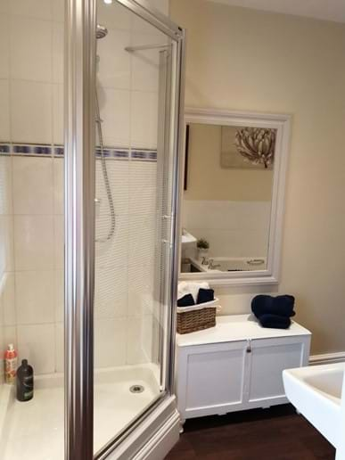 Separate corner shower
