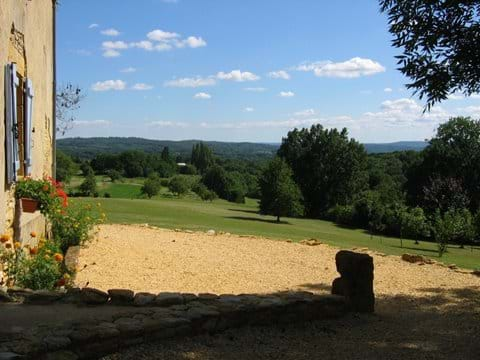 the side terrace of the gite with views over the Dordogne