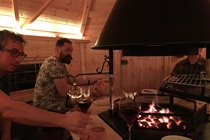 Guests enjoying the Scandinavian barbecue cabin