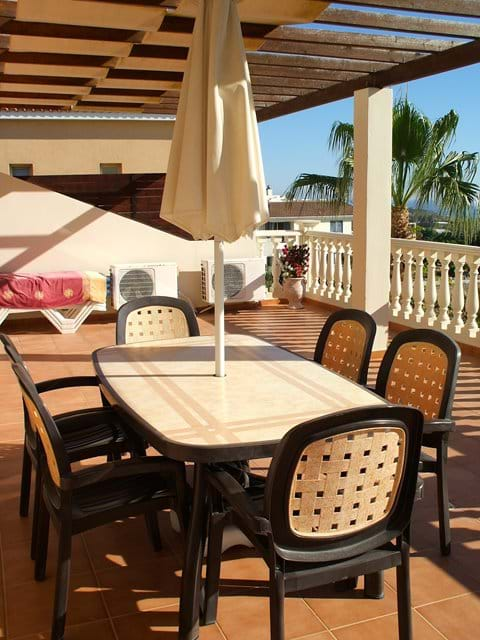 Enjoy meals and drinks on the balcony