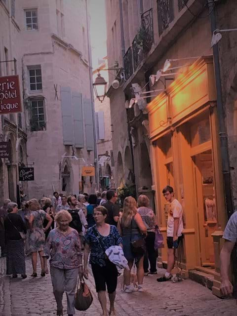 Late night shopping in the old town of Pézenas