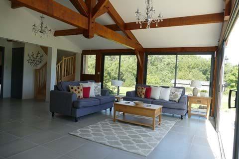 Open plan stylish interiors open to the rafters with traditional beams