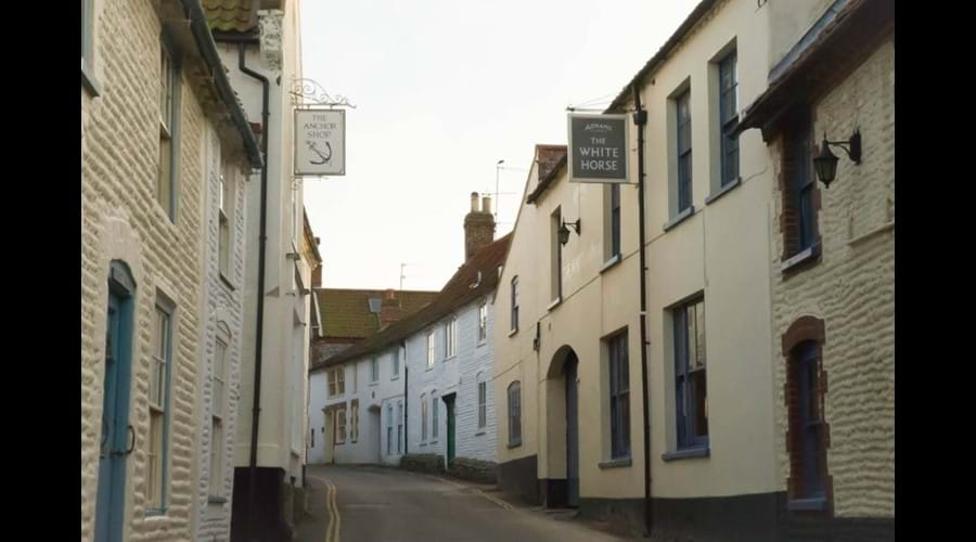 Blakeney High Street - Benbow Cottage is the white house on the right