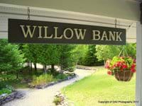 The Willow Bank sign welcomes visitors to the cottage