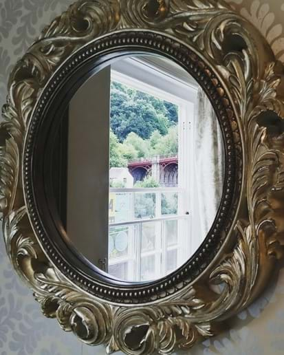 WONDERFUL VIEW OF THE IRON BRIDGE REFLECTING IN THE LOUNGE MIRROR AT IRONBRIDGE VIEW TOWNHOUSE