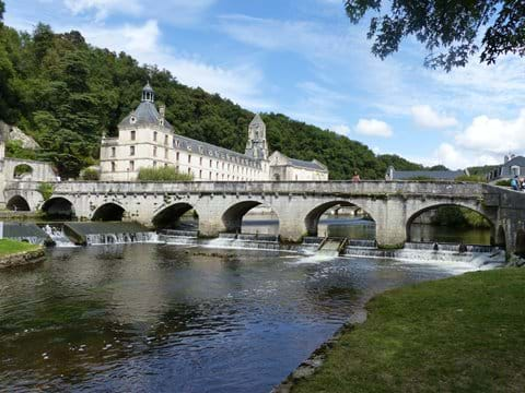 View of the monastery from the river in Brantome