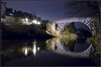 NIGHT TIME VIEW OF THE IRON BRIDGE