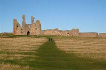 Dunstanburgh Castle, approaching from Craster