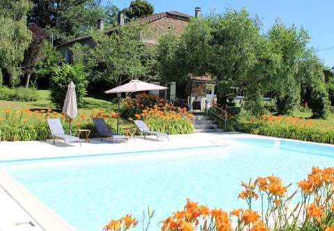 Large pool surrounded by garden and orange day lilies