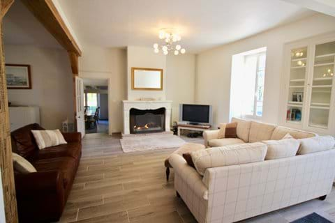 Spacious lounge with views onto terrace and garden