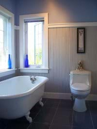 Clean spacious bathroom features deep claw foot tub and a glass-door shower stall