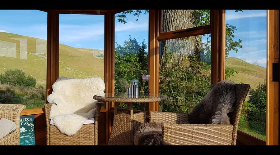 The summerhouse is perfect for dining whilst enjoying the views