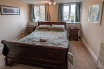 2nd Floor Double Bedroom with king size bed, wardrobe and chest of drawers