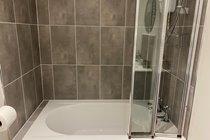 Bath with overhead shower