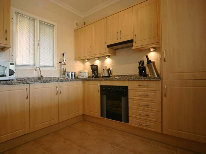 Fully equipped modern kitchen with dishwasher, oven, kettle, toaster, juicer, fridge freezer, microwave and every imaginable gadget