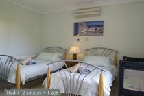 Bed 4 has 2 single beds + 1 cot + air con overlooks the rear garden
