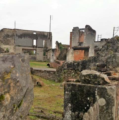 Oradour sur Glane buildings without roofs and deserted car