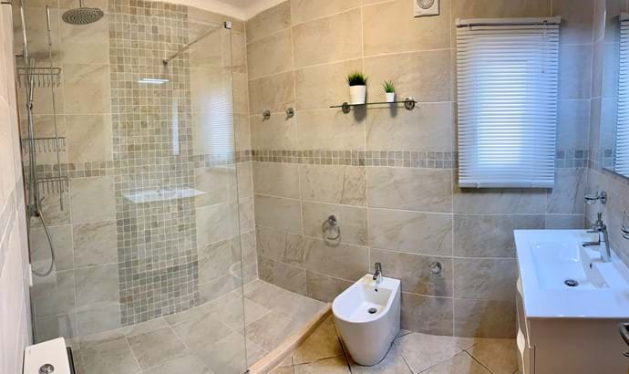 Main bathroom with walk in shower and modern suite