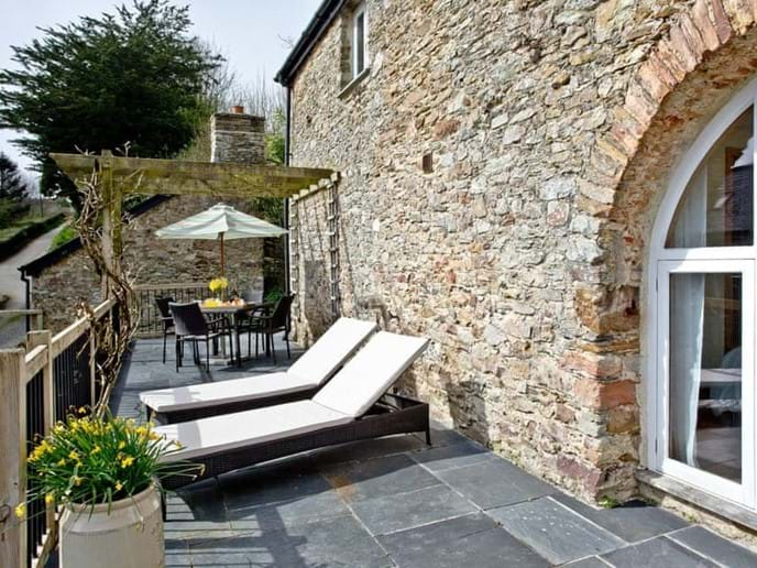 Relax and enjoy the bird song on the South Facing Sun Terrace& Dining Area