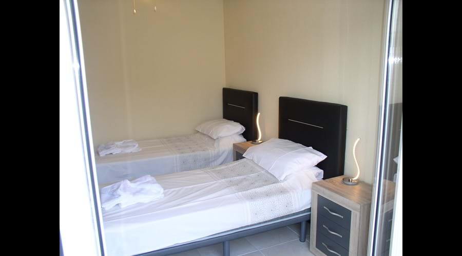 Lovely twin room with Stylish Beds and furniture