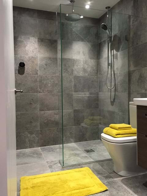 Wetroom with dual rainwater/fixed shower heads.