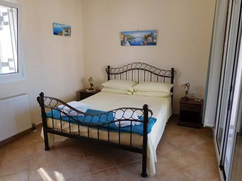 Bedroom 1 which has its own private balcony and ensuite bathroom