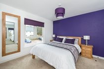 Contemporary and generous king bedroom with ensuite