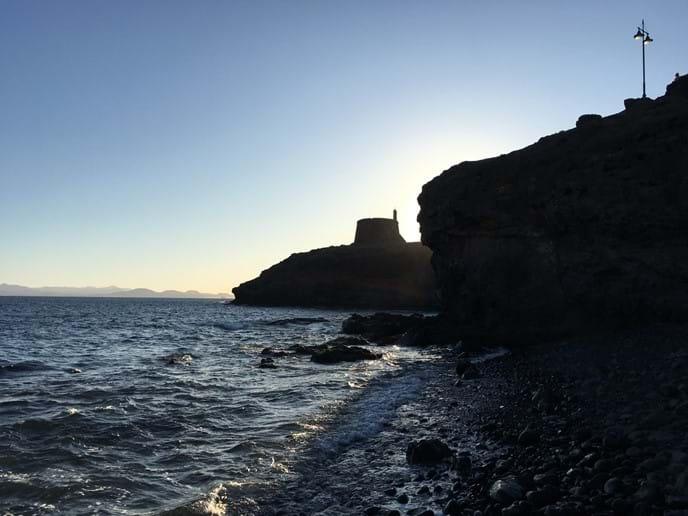 Castillo / Torre del Águila photo taken from sea shore next to coastal path from Las Coloradas to Marina Rubicon