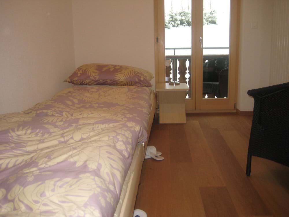 Third Bedroom with Twin Beds and Small Balcony