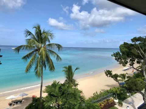 Looking up Paynes bay from Coral Cove 12 balcony. View of the sandy beach and the beautiful blue sea in front of coral cove