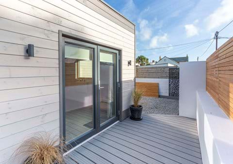 South facing patio doors open onto a private enclosed decking area
