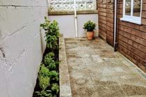 Back Yard with Secure Cycle Storage and Herb Plants
