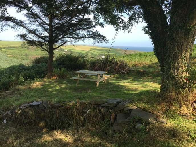 Picnic table in the garden with view of Galley Head