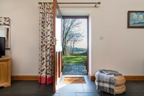 Holiday cottage close to Criccieth front door opening onto enclosed garden