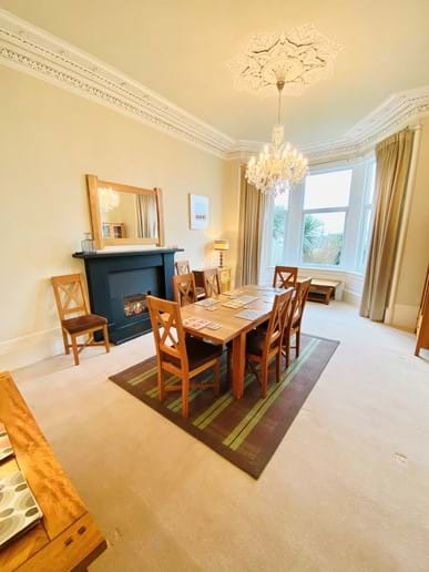 Dining room with large table with 8 seat. Stunning sea view (waiting for two sumptuous armchairs for the bay window after lockdown!)