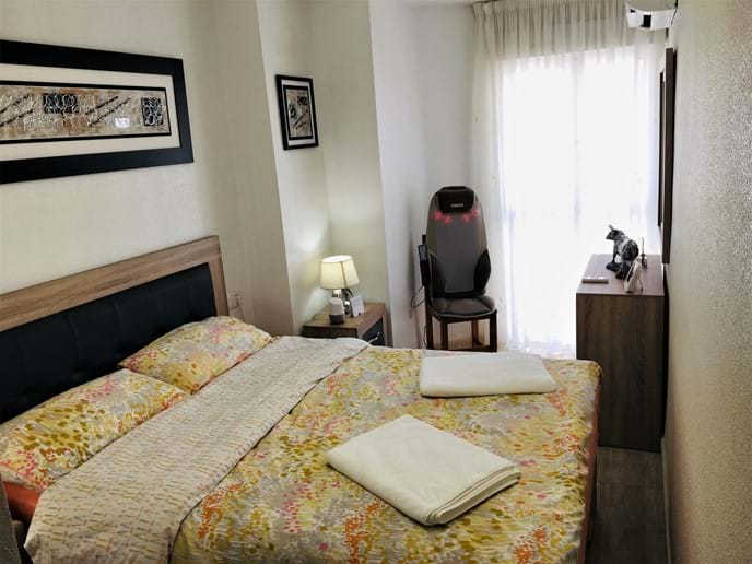 Holiday apartment - master bedroom: luxury bed, HoMedics massager and aircon