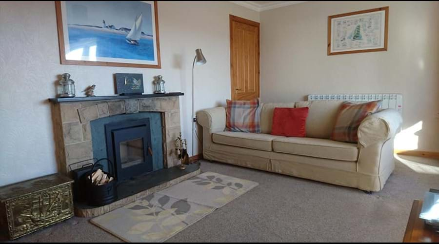 The living room showing the log burning inset stove