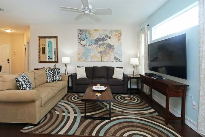 """Large, light and airy living area with large 46"""" TV at our 2 bedroom condo 7-108"""