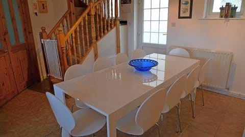 White gloss table seating 10 people