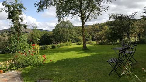 Seating area in the garden, loverlooking the mountains