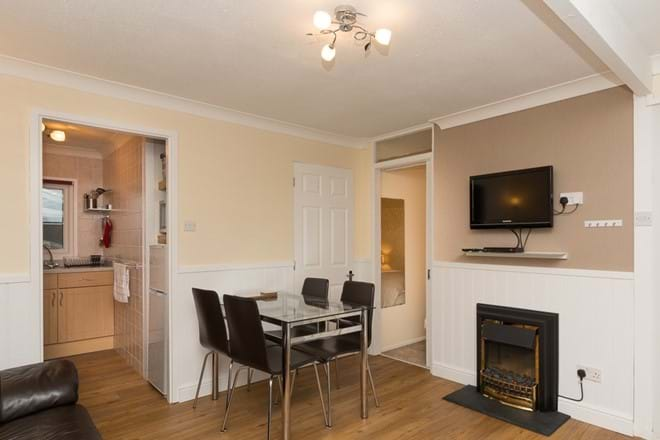 Open plan dining area with flat screen TV, DVD & feature fire