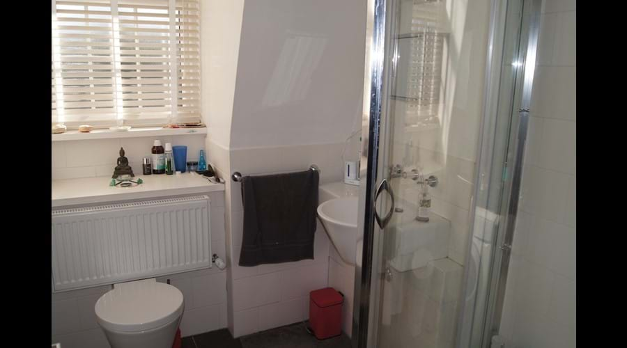 En-suite shower room also houses washing machine
