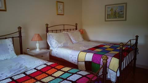 Second bedroom with the cottages original wrought iron beds a double and a lady
