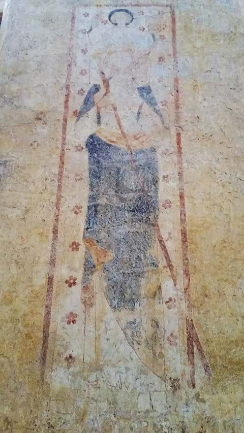 St Avit Senieur with medieval faded wall fresco of a woman