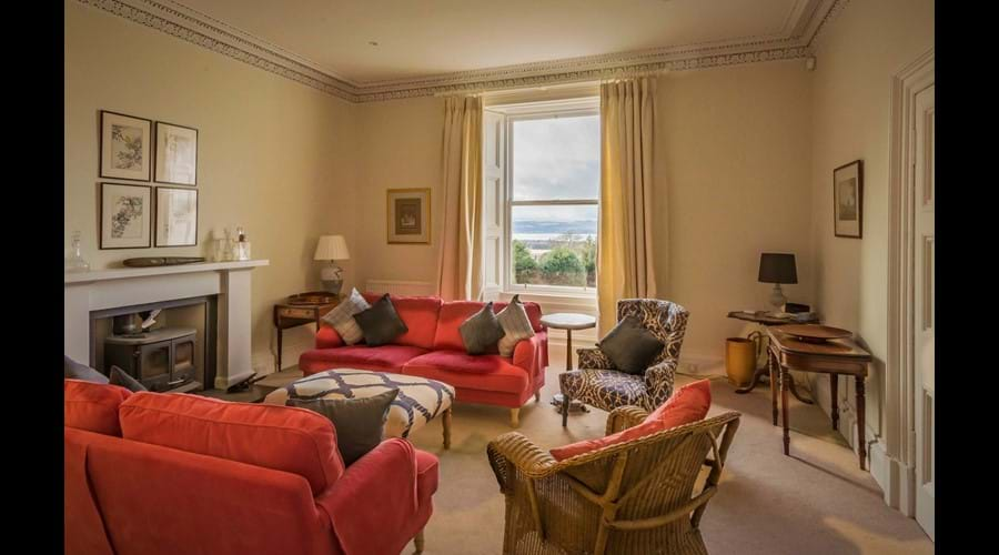 The main sitting room with it's large sofas and wonderful views is a beautiful space
