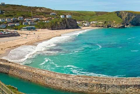 Portreath harbour with stunning turquoise sea.